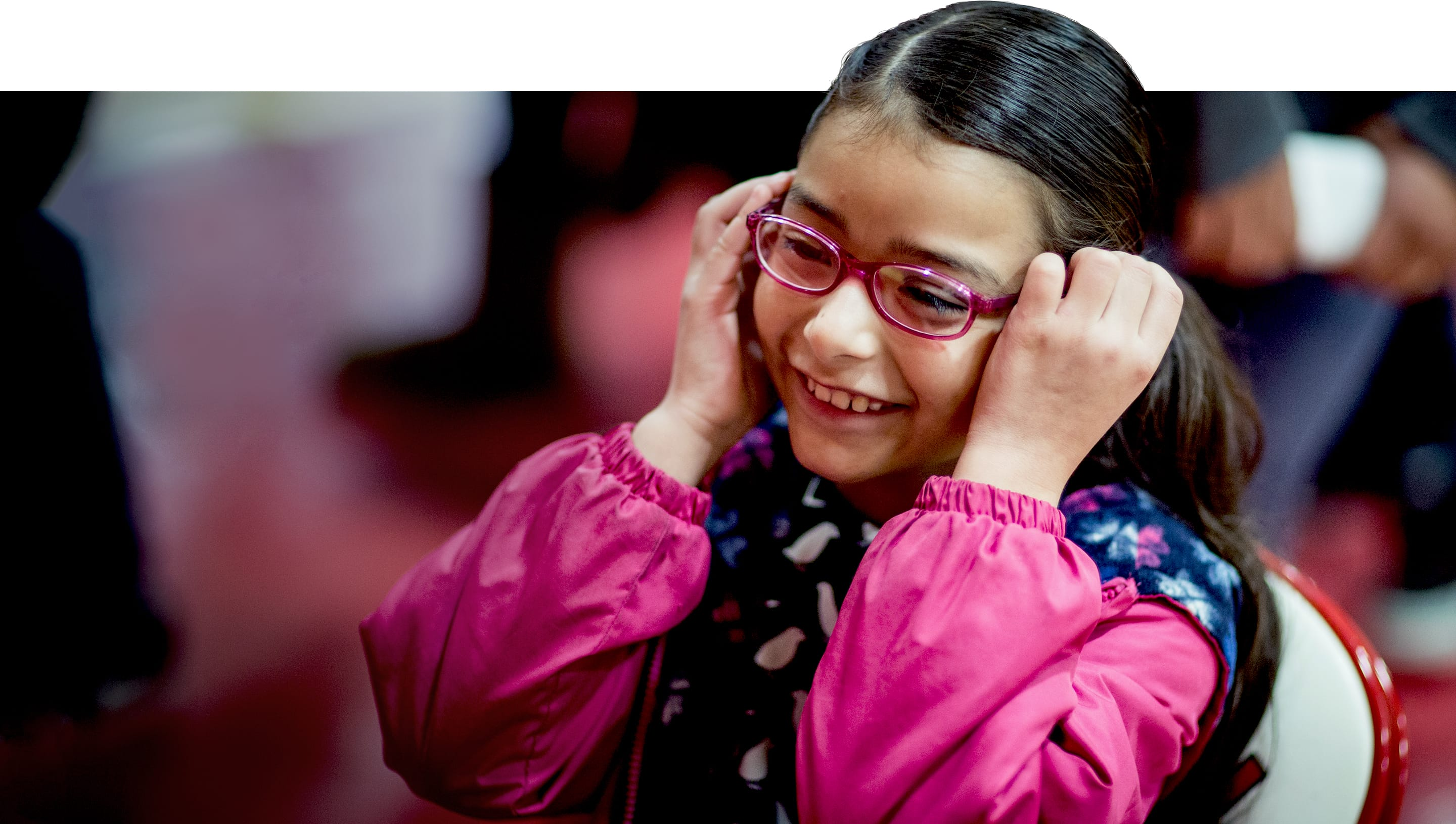 OneSight beneficiary tries on donated glasses for the first time